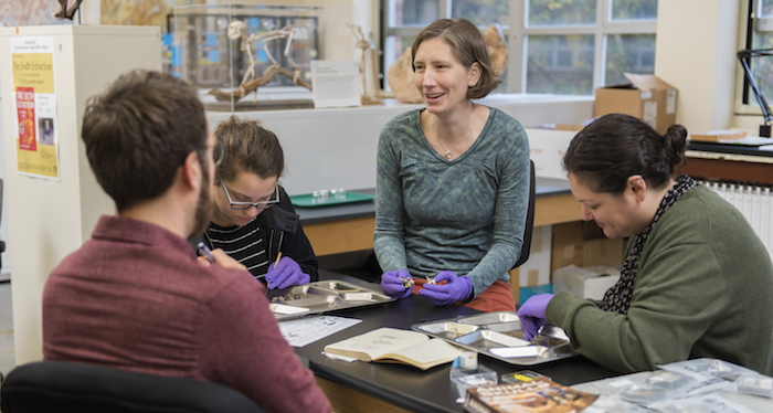 photo of Rebecca Terry working with students