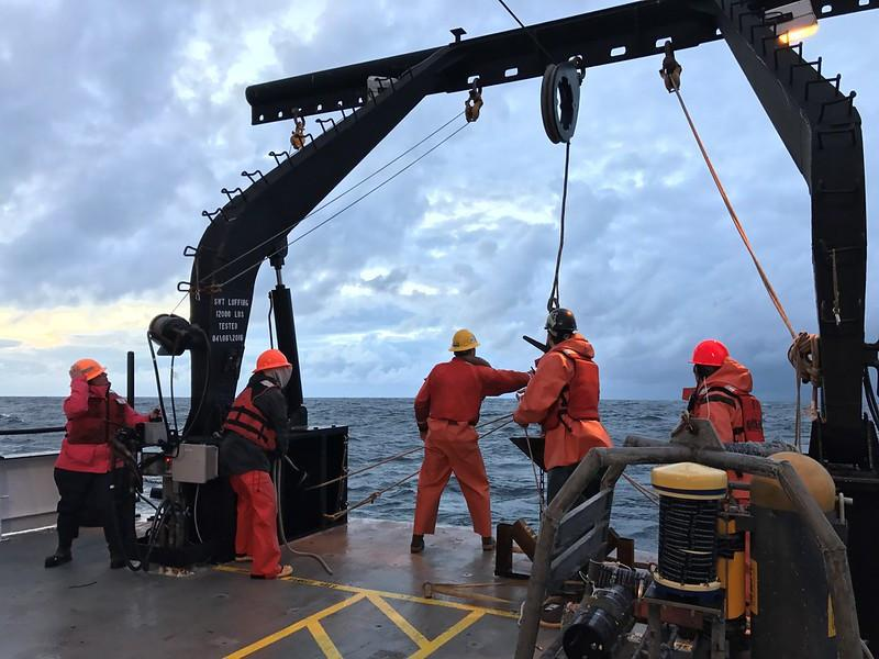 researchers working on ship on the ocean