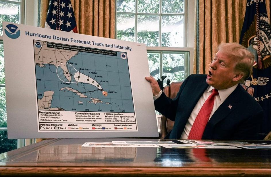 President Trump with hurricane map